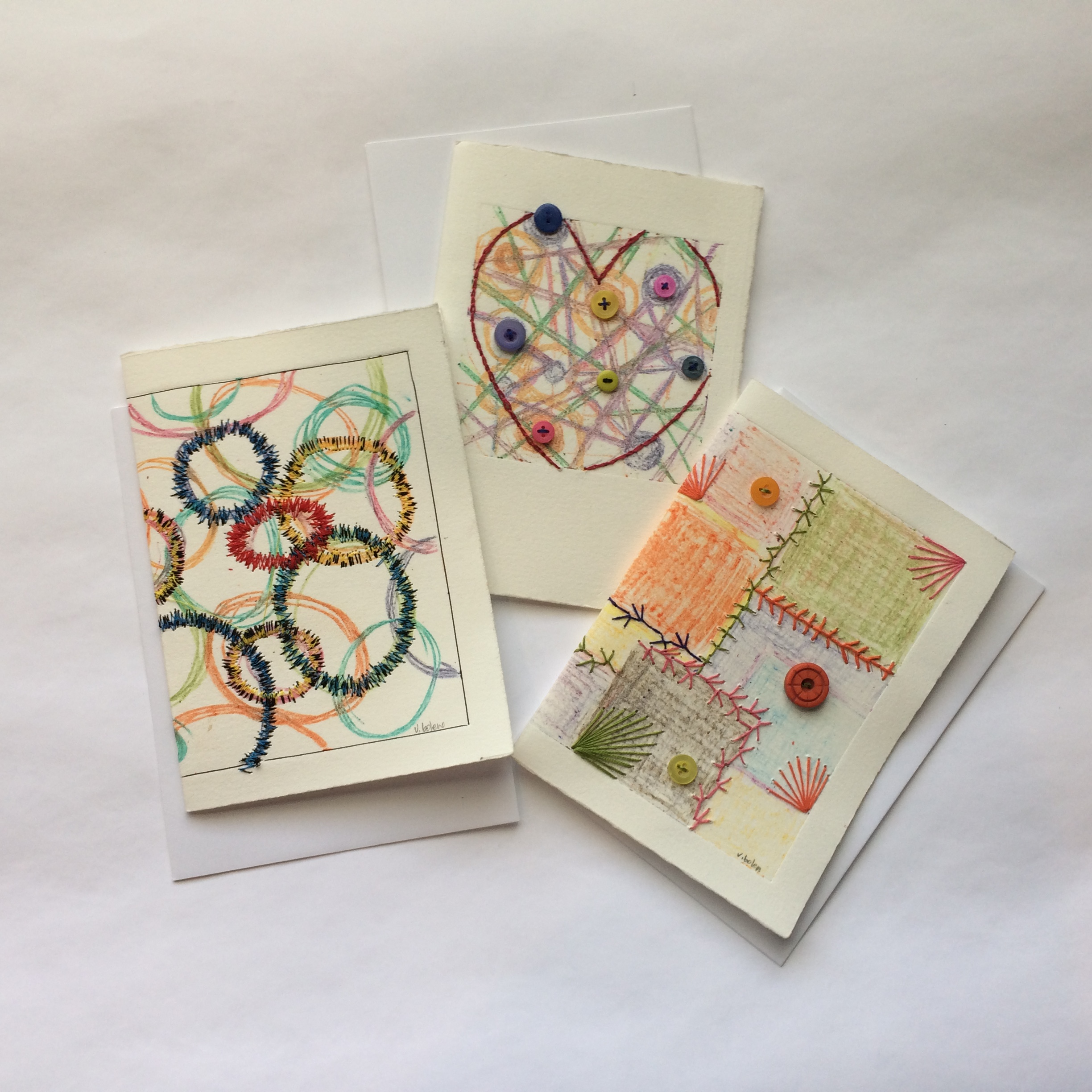 New cards featuring hand and machine embroidery.