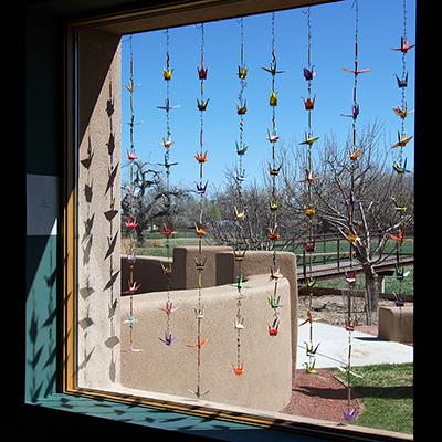 573_12_cranes_Tyvek_origami_crane_outdoor_art_garden_mobile
